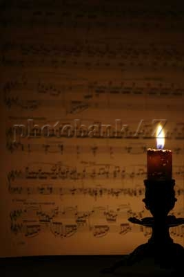 candle and music paper