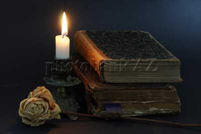 old books,candle and flower