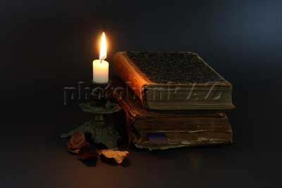 candle and old books