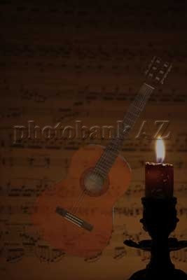 candle, music paper and guitar