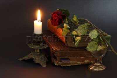 candle, flower and old books