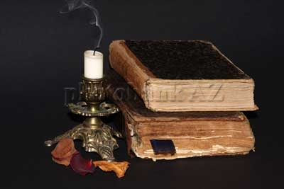 candle, rose leaf and old books