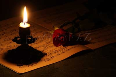 candle, rose and music paper