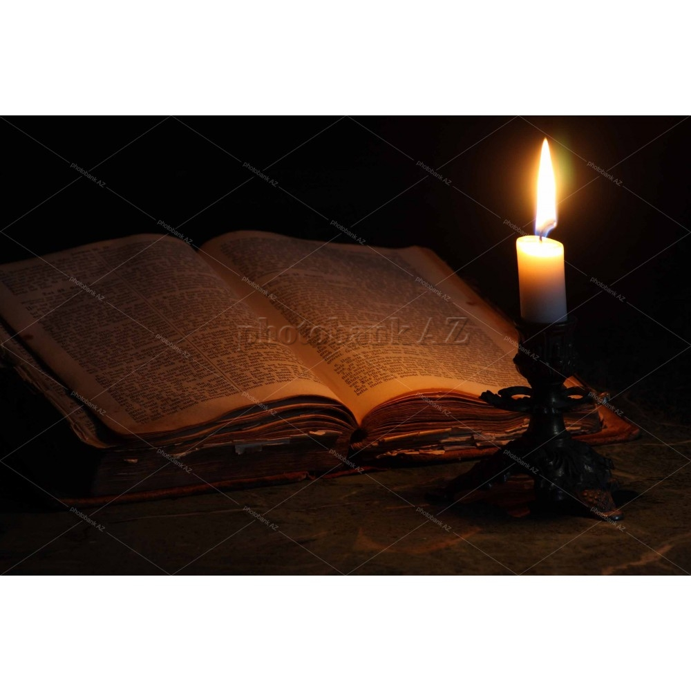 candle and old book