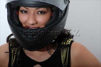 Girl with a motorcycle helmet